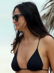 Demi Moore showing side-boob in a tiny black bikini at the beach in Mexico