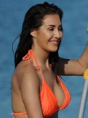 Chloe Goodman busty and booty in skimpy orange bikini paddleboarding in Mexico