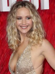 Jennifer Lawrence braless showing huge cleavage at the Red Sparrow premiere in London