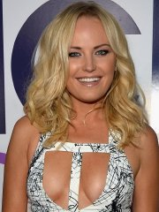 Malin Akerman braless wearing a wide open dress at the 40th Annual People's Choice Awards in LA