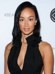 Draya Michele braless shows side-boob and big cleavage at Beautycon Festival in LA