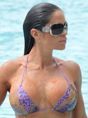 Michelle Lewin shows off her big boobs and ass in colorful thong bikini poolside in Miami