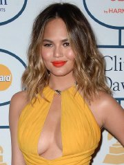 Chrissy Teigen showing huge cleavage at the 56th Annual GRAMMY Awards Pre-GRAMMY Gala in LA