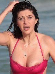 Brittny Gastineau hot nipple-slip in a skimpy red swimsuit at the beach in Miami
