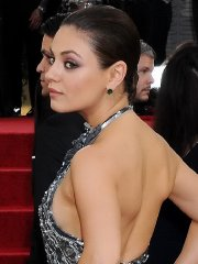 Mila Kunis braless shows side-boob in a sparkling gown at Annual Golden Globe Awards