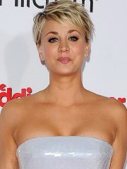 Busty Kaley Cuoco wearing a strapless dress at 'The Wedding Ringer' premiere in Hollywood