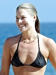 Ali Larter showing hard pokies in a tiny black bikini at the beach in Miami