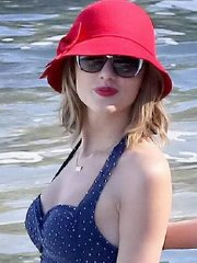 Taylor Swift looks hot in a retro polka-dot swimsuit at the beach in Maui