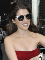 Anna Kendrick busty in red strapless dress arriving at The Late Show with Stephen Colbert in NYC