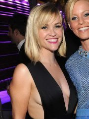 Reese Witherspoon braless shows side-boob and huge cleavage at the Oscars 2014 Vanity Fair Party in West Hollywood