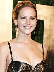 Jennifer Lawrence showing huge cleavage at the 2013 Vanity Fair Oscar Party in West Hollywood