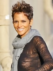 Halle Berry braless shows off her big boobs in see-thru top at Jimmy Kimmel's live show in LA