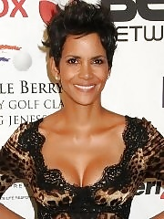 Halle Berry busty wearing a leopard print dress at Jenesse Silver Rose Benefit in Beverly Hills