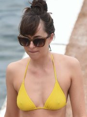 Dakota Johnson see-through to muff and pokies in wet yellow bikini at the beach in France