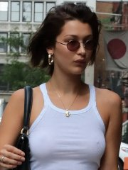 Bella Hadid shows pokies braless in slightly sheer white tank top and jeans out in NYC