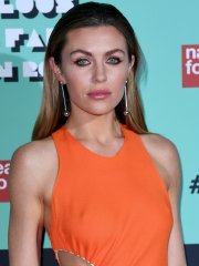 Abigail Clancy showing nipple-pokies braless in sheer orange dress at the event in London