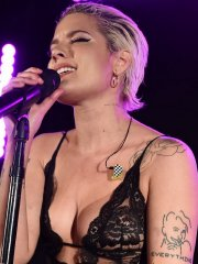 Halsey shows off her boobs in black lace see-through top while performing at YSL Beauty Festival