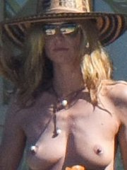 Heidi Klum caught topless wearing only black panties while on vacation in St.Barts