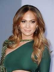 Jennifer Lopez shows off her curvy body wearing green skin tight dress at BAFTA event