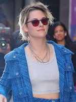 Kristen Stewart shows pokies & leggy braless in a crop top and short skirtsuit leaving Good Morning America in NYC