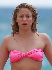 Shakira shows off her juicy ass wearing two bikini sets at the beach while on vacation in Hawaii