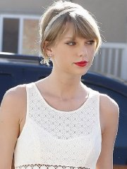 Taylor Swift leggy wearing white slightly see-through mini dress out in Los Angeles