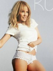 Kylie Minogue looking very sexy in her official 2014 calendar photoshoot