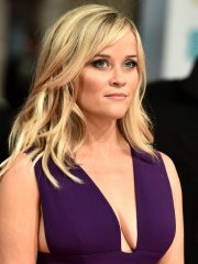 Reese Witherspoon showing side-boob and huge cleavage at the EE British Academy Film Awards 2015 in London