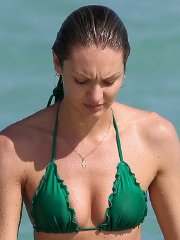 Candice Swanepoel wetting her perfect green thong bikini ass at the beach in Miami