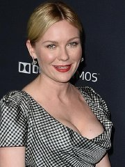Kirsten Dunst showing huge cleavage at the 'Unbroken' premiere in Hollywood