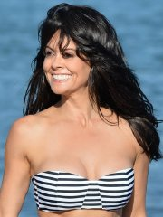 Brooke Burke busty wearing tube striped two-piece at the beach in Malibu