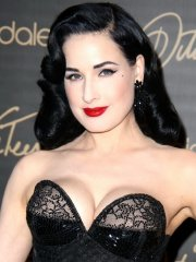 Dita von Teese showing huge cleavage at her lingerie line launch in NYC