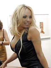 Pam Anderson in wide open black top and shorts