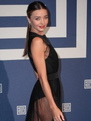 Miranda Kerr shows off her legs and ass wearing a partially see through dress at Shiatzy Chen show during Paris Fashion Week