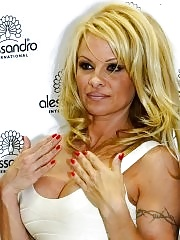 Pamela Anderson busty wearing a tight white dress at the 'Striplac' nail polish presentation