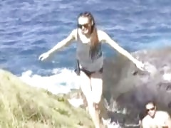 Lindsay Lohan's stoned ass trekking rocky cliffs for a little getaway from the paps