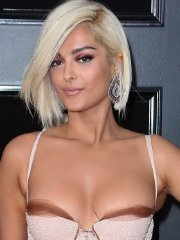 Bebe Rexha busty & booty in revealing fishtail sequined dress at the 60th Annual Grammy Awards