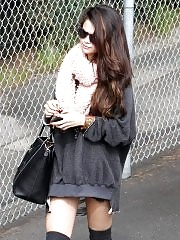Selena Gomez leggy wearing socks & poncho outside a studio in LA