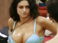 Cristina Del Basso rubs lotion on her huge tits