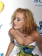 Katy Perry leggy wearing ultra short white dress at The Smurfs premiere in NYC