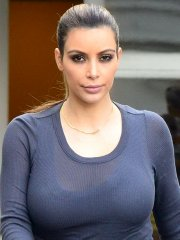 Kim Kardashian see through to bra while out shopping