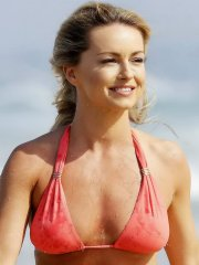 Ola Jordan shows off her hot body in tiny orange bikini at the Surfers Paradise beach