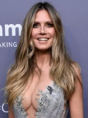 Heidi Klum shows off her boobs braless in a plunging gray lace dress at 2019 amfAR Gala in NYC