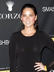 Olivia Munn braless wearing tight black see-through dress at 'LiveStrong Foundation Benefit'