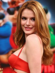 Bella Thorne busty in a low-cut red leather dress at Despierta America in Miami