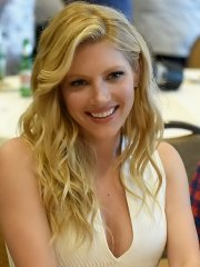 Katheryn Winnick showing big cleavage in a tight white dress at the Vikings Press Line at Comic Con in San Diego