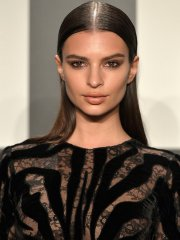 Emily Ratajkowski braless wearing black see-through dress at 2015 Tom Ford Collection Presentation & Women In Film Pre-Oscar Cocktail Party in LA