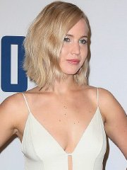 Jennifer Lawrence braless wearing low cut white dress at the Joy premiere in NYC