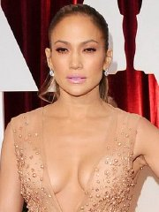Jennifer Lopez braless showing huge cleavage in flesh colored dress at 87th Annual Oscars in Hollywood