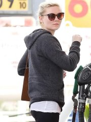 Kirsten Dunst shows off her ass in black tights while pumping gas in LA